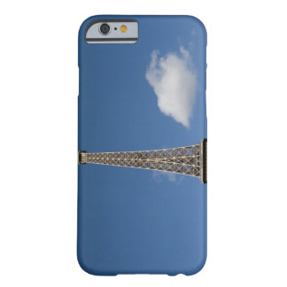 white clouds against blue sky behind the Eiffel Barely There iPhone 6 Case
