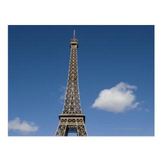white clouds against blue sky behind the Eiffel Postcard