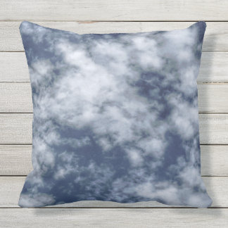 White clouds against blue sky on throw pillow
