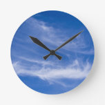 White clouds on blue sky round wallclocks
