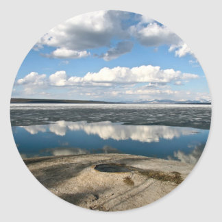 WHITE CLOUDS OVER LAKE WITH VOLCANIC CONE CLASSIC ROUND STICKER