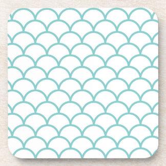White coasters with blue scallop design