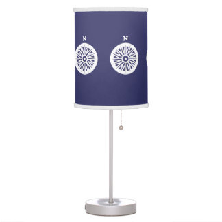 White Compos N north on blue background Table Lamp
