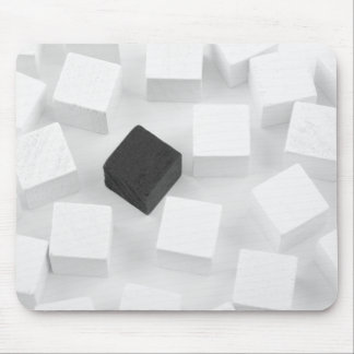 White cubes with one black mouse pad