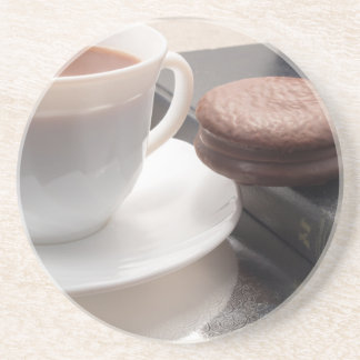 White cup of hot chocolate and cookies drink coaster