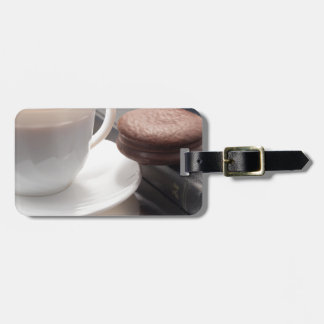 White cup of hot chocolate and cookies luggage tag