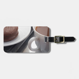 White cup with cocoa and chocolate covered biscuit bag tag