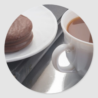 White cup with cocoa and chocolate covered biscuit classic round sticker