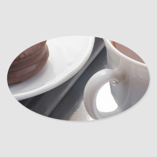 White cup with cocoa and chocolate covered biscuit oval sticker