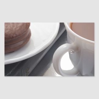 White cup with cocoa and chocolate covered biscuit rectangular sticker