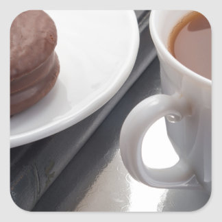 White cup with cocoa and chocolate covered biscuit square sticker