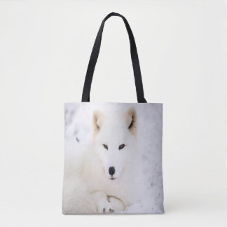 White cute fox in snow looking at you tote bag