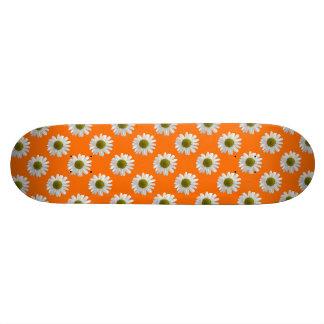 White daisies on orange skateboard deck