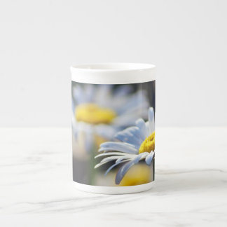 White daisy and its meaning tea cup