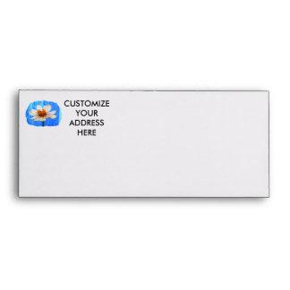 White daisy flower against light blue background envelope