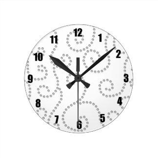 White diamonds swirls round clock
