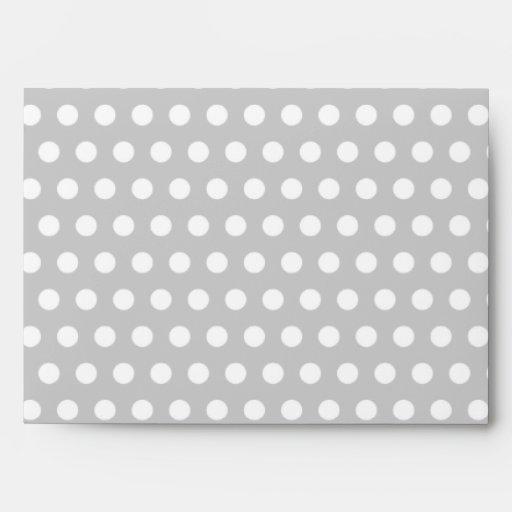 White Dots on Light Grey Envelopes