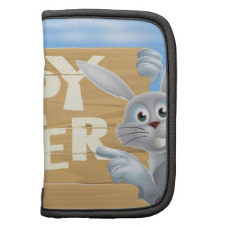 White Easter bunny pointing at sign Planner