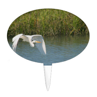 White Egret flying over water grass Oval Cake Toppers