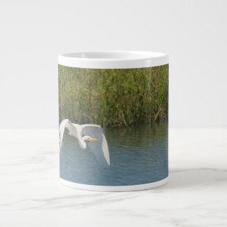 White Egret flying over water grass Giant Coffee Mug