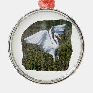 White Egret landing in marsh Round Metal Christmas Ornament