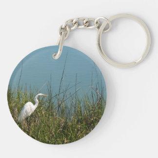 White egret standing in grass w water keychain