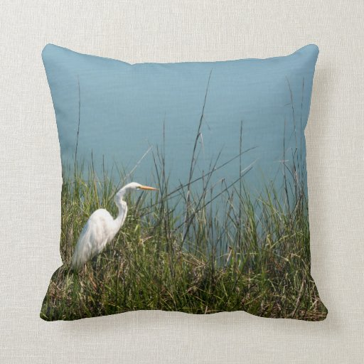 White egret standing in grass w water throw pillows