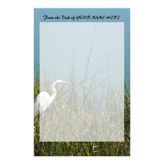 White egret standing in grass w water stationery