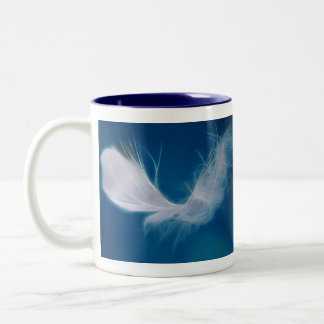 White feather art - symbol of purity and innocence Two-Tone coffee mug