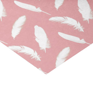 White feather print on shell pink tissue paper
