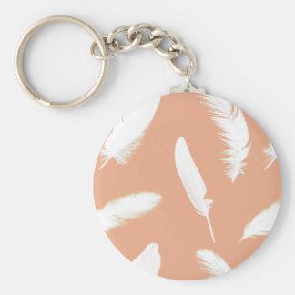 White feather print on soft peach keychain