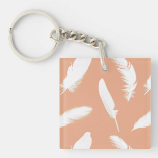 White feather print on soft peach keychain