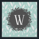 """White Feathers and Arrows Pattern with Monogram Faux Canvas Print<br><div class=""""desc"""">A light blue background with a beautiful pattern of feathers and arrows. The feathers are two and two next to each other, pointing different ways, and the arrows are under the faethers , pointing at the same direction as the feather above them. There are also modern looking triangles pointing down....</div>"""