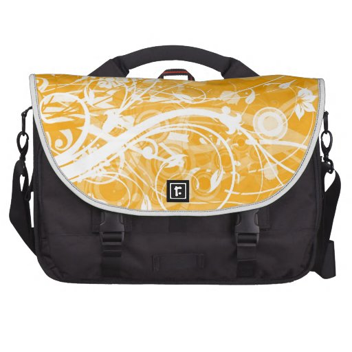 white floral swirls on yellow background commuter bag
