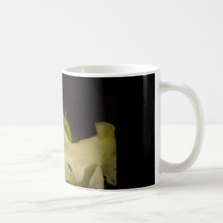 White flower in the darkness coffee mug