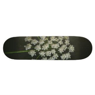 White flower macro skate deck