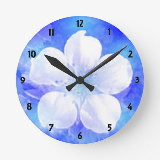 White flower on a blue background Wall Clock