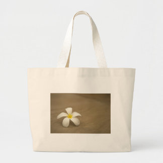 White flower on stone background canvas bags