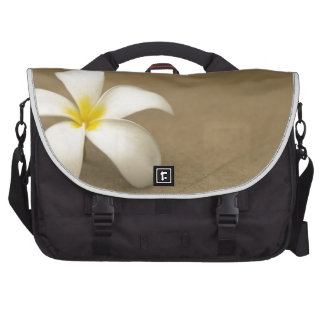 White flower on stone background commuter bags