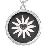White flower with black & white heart on black pendant