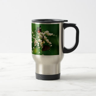 White flowers and a fluttering butterfly mugs