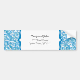 white flowers and leaves on blue car bumper sticker