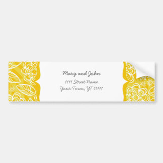 white flowers and leaves on yellow bumper sticker
