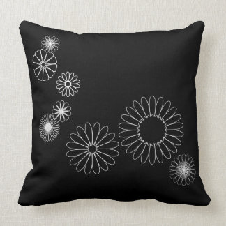 White Flowers Scattered on Black Pillow