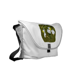 White flowers yellow center round buds messenger bag