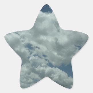White, fluffy clouds in blue sky star sticker