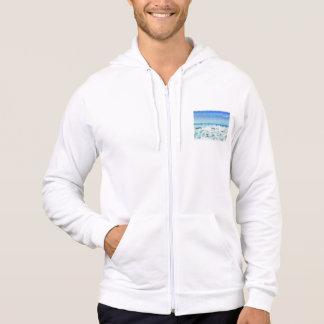 White foamy water near the beach hoodie