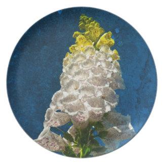 White Foxglove flowers on texture Dinner Plate