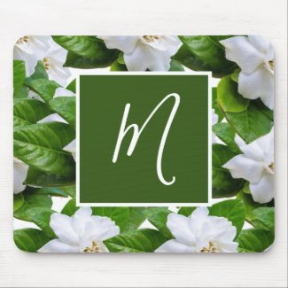 White gardenia flowers and green leaves mouse pad