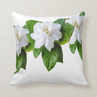 White  gardenia flowers and green leaves on white throw pillow